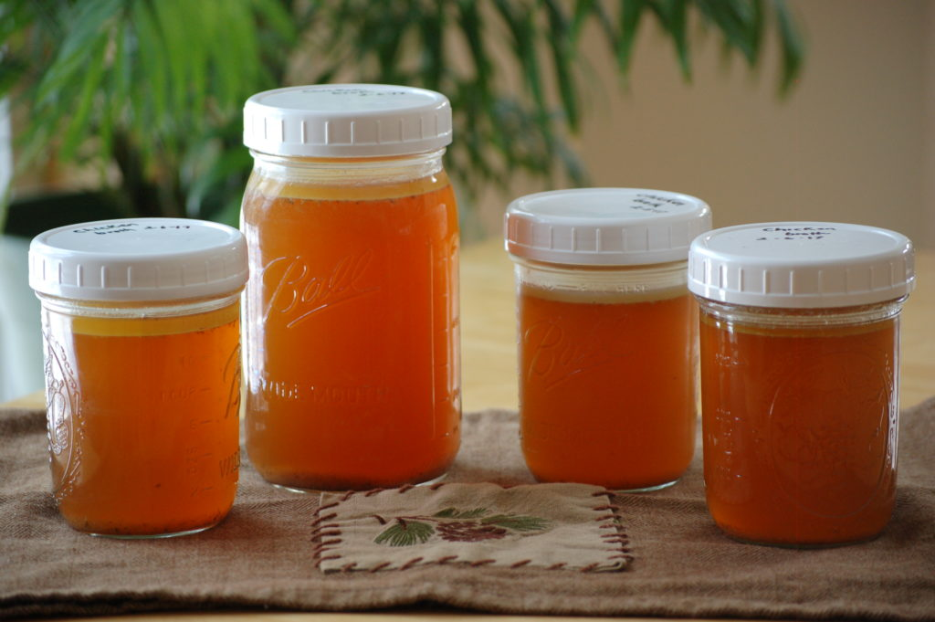 Chicken broth in jars