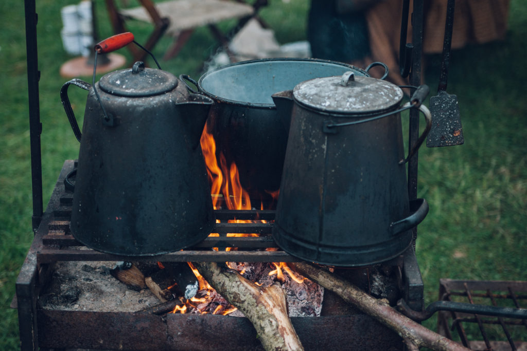 Affordable camping meals cooked over a campfire.